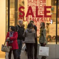 Warm winter means damp profits for Fast Retailing