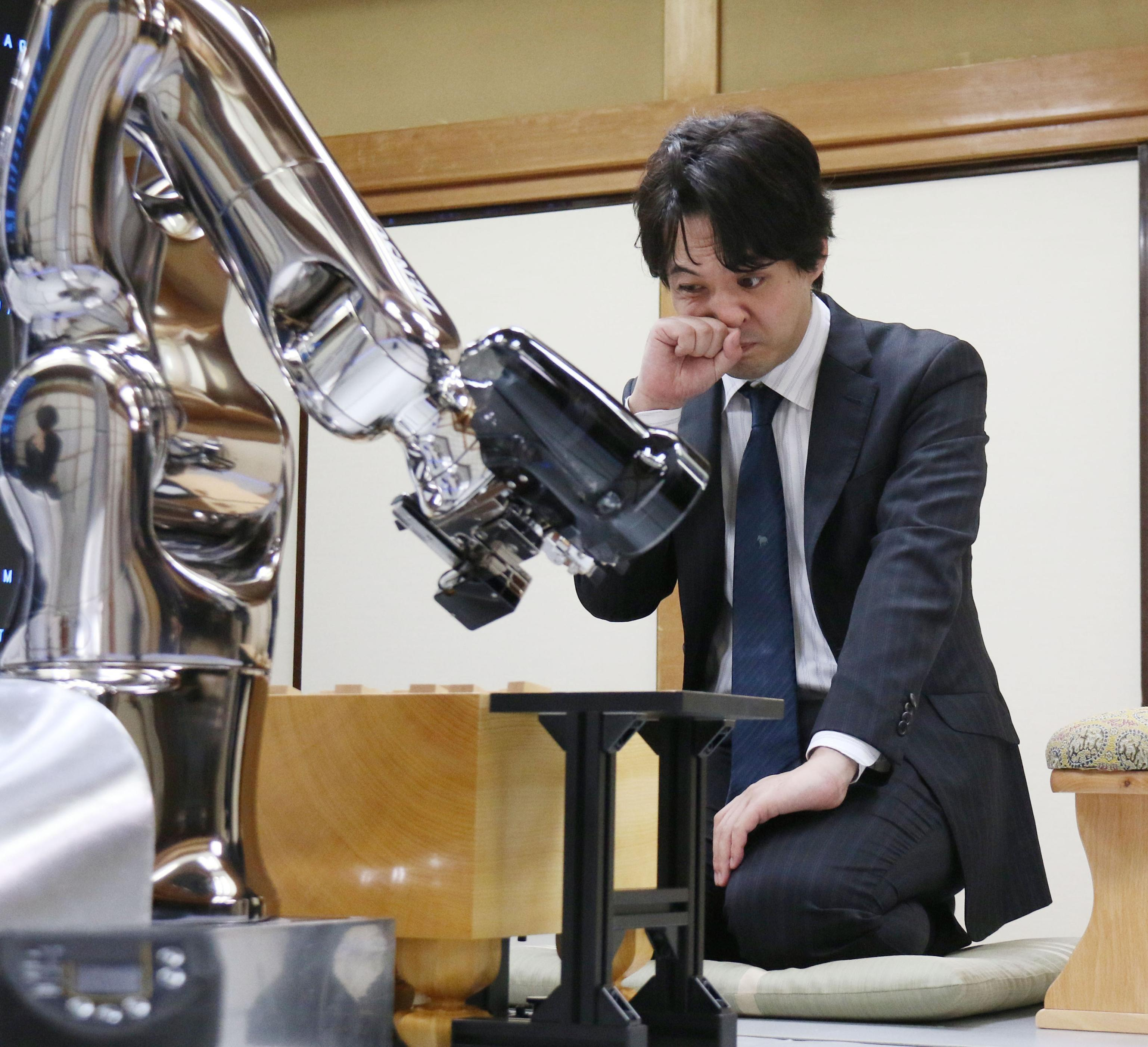 A computer plays against a professional shogi (Japanese chess) player in April 2015 in Tokyo's Shibuya Ward. | KYODO