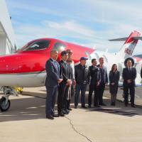 Officials with Honda Aircraft Co. and local dealers attend a ceremony Friday in Phoenix, Arizona, to mark the first deliveries of HondaJet — the Japanese automakers's small business aircraft — to the United States. | KYODO