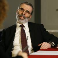Libyan national oil company chief Mustafa Sanalla talks during an interview in London Monday. The head of Libya's state oil corporation is appealing for political factions to forge a unity government, saying that without a single government there will be neither security nor stability. | AP