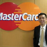 Ling Hai, co-president of MasterCard's Asia-Pacific region, poses for a photo at the firm's Tokyo office this month. | KAZUAKI NAGATA
