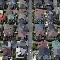 Houses stand in Urayasu, Chiba Prefecture. Rich buyers said to be taking advantage of record low borrowing costs have pushed prices in parts of greater Tokyo beyond the reach of ordinary buyers. | BLOOMBERG