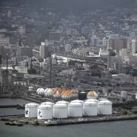 Oil tanks stand at a refinery in the Shunan industrial complex in Shunan, Yamaguchi Prefecture, in July. | BLOOMBERG