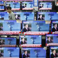 TV sets carry a news report about North Korea's nuclear test at a store in Seoul on Wednesday. | REUTERS