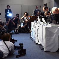 Auto parts maker Takata Chairman and President Shigehisa Takata (second, right) and company executives bow in June over the global recall of the company's airbags, at a press conference after the company's shareholders meeting in Tokyo. | AFP-JIJI