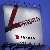 A billboard advertisement of Takata Corp. is pictured in Tokyo in 2014. U.S. auto safety regulators said Tuesday that air bag maker Takata declared 5.1 million U.S. vehicles defective, as the company disclosed an 11th death could be linked to a faulty air bag. | REUTERS