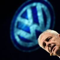 Volkswagen CEO Matthias Mueller speaks during a press event on the eve of the official press preview of the 2016 North American International Auto Show in Detroit on Sunday. | AFP-JIJI