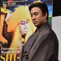 What happens in Vegas: Kabuki actor Ichikawa Somegoro VII stands in front of a promotional poster for the production he will take to Las Vegas in May. | AFP-JIJI