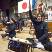 They bang the drums: Members of the Yamakiya Taiko drumming ensemble practice for a performance in Fukushima Prefecture last month. | KYODO