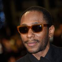 Visa worries: U.S. rapper Yasiin Bey, better known as Mos Def, arrives at the Cannes Film Festival last year. He appeared in a South African court last week after being arrested for allegedly using an illegal 'world passport.' | AFP-JIJI
