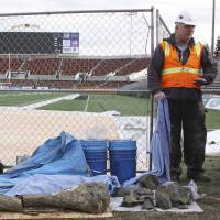 Oregon State University archaeologist Loren Davis stands near Reser Stadium on Jan. 26 after mammoth bones were found at a construction site in Corvallis, Oregon. | AP