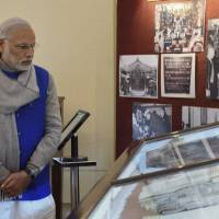 Indian Prime Minister Narendra Modi looks at documents displayed at the National Archives of India where he released the digital copies of 100 declassified files related to Netaji Subhash Chandra Bose in New Delhi on Saturday. | AP