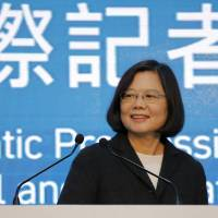 Democratic Progressive Party (DPP) presidential candidate Tsai Ing-wen announces her election victory to the media at party headquarters in Taipei on Saturday. | REUTERS