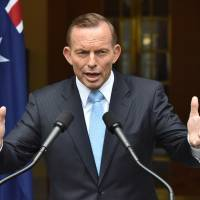 Ousted Australian leader Abbott announces he will seek another term in parliament