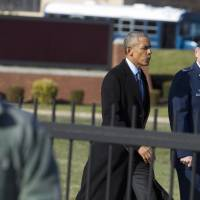 President Barack Obama, accompanied by the Commander of 89th Airlift Wing Col. John Millard, walks toward Air Force One after a meeting with King Abdullah II bin Al-Hussein of Jordan at Andrews Air Force Base, Maryland, Wednesday.   AP