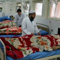 Doctors assist the wounded in a hospital after they were injured in a suicide attack, inside a  house, in Jalalabad, capital of Nangarhar province, Afghanistan, Sunday. | AP
