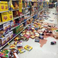 Cereal and bottles of juice lie on the floor of a Safeway grocery store following a magnitude-6.8 earthquake on the Kenai Peninsula on Sunday in south-central Alaska. | VINCENT NUSUNGINYA VIA AP