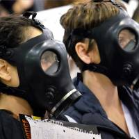 Protesters attend a hearing over a gas leak from the Aliso Canyon storage facility in Los Angeles on Jan. 16. | AP