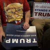 A man wearing a T-shirt supporting Donald Trump's presidential bid attends a campaign rally in Claremont, New Hampshire, on Jan. 5. | BLOOMBERG