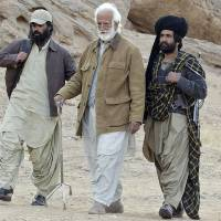 This file photograph taken on Jan. 24, 2006, shows the late Pakistani rebel Bugti tribal leader Nawab Akbar Bugti (center) with his tribal bodyguards in the remote mountainous area of Dera Bugti in Pakistan's southwestern Baluchistan province. | AFP-JIJI