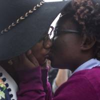 Tori Sisson (left) and Shante Wolfe kiss last Februay after saying their marriage vows in Montgomery, Alabama. Sisson and Wolfe were the first same-sex couple to file their marriage license. | AP
