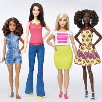 The new Barbie body shapes of petite, tall and curvy are seen next to the traditional Barbie (right). | REUTERS