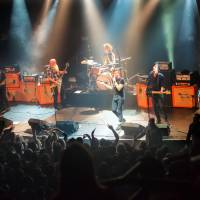 American rock group Eagles of Death Metal performs on stage Nov. 13 at the Bataclan concert hall in Paris moments before four men armed with assault rifles and shouting 'Allahu akbar' ('God is great!') stormed into the venue killing 90 people. | MARION RUSZNIEWSKI / ROCK%FOLK / AFP-JIJI