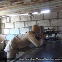 Besieged by Syrian regime, Islamic State, city's starving citizens sell all for food, way out