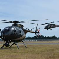 A Washington National Guard UH- 60 Black Hawk helicopter (right) lands next to a Snohomish County Sheriff's Department helicopter last July during exercise Evergreen Tremor, to prepare for a Cascadia Subduction Zone earthquake. | WASHINGTON STATE ARMY NATIONAL GUARD VIA AP