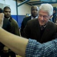Former U.S. President Bill Clinton, husband of Hillary Clinton, former secretary of state and 2016 Democratic presidential candidate, takes a selfie photograph with Stephan Rodriguez after speaking during a campaign rally at Nashua Community College in Nashua, New Hampshire, on Monday. | BLOOMBERG