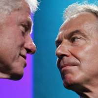 Former U.S. President Bill Clinton and former British Prime Minister Tony Blair talk at the Clinton Global Initiative in New York in September 2010. | AP