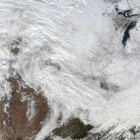 A large winter storm that is expected to bring heavy snowfall to the U.S. Mid-Atlantic region on Friday and Saturday is seen Wednesday in this NASA handout photo. Washington, D.C., and New York City were under blizzard watches Thursday and states of emergency were declared in Virginia, Maryland and North Carolina ahead of a blustery weekend storm expected to slam the East Coast with up to 2 feet (60 cm) of snow. | REUTERS/NASA/HANDOUT VIA REUTERS