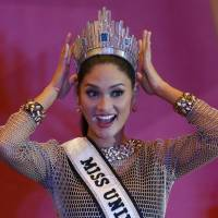 Newly crowned Miss Universe Pia Alonzo Wurtzbach shows off her crown during a news conference in suburban Quezon City, northeast of Manila, on Sunday. | AP