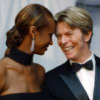 Supermodel Iman and her husband, singer David Bowie, arrive at the Council of Fashion Designers of America Fashion Awards in New York in June 2002. Bowie, the innovative and iconic singer whose illustrious career lasted five decades, died Sunday after battling cancer for 18 months. He was 69. | AP
