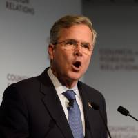 2016 Republican Presidential hopeful Jeb Bush speaks at the Council on Foreign Relations Tuesday in New York. Bush took a swipe at frontrunner Donald Trump in the billionaire's home town Tuesday, accusing him of 'talking trash' and saying he would be demolished in a general election. | AFP-JIJI