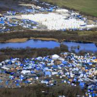 The sprawling 'Jungle' migrant camp is seen Sunday in Calais, northern France. | REUTERS