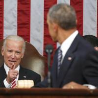 Vice President Joe Biden points at President Barack Obama during the president's State of the Union address Tuesday to a joint session of Congress on Capitol Hill in Washington. Harking back to America's triumphant race into space, the Obama administration is launching what it calls a 'moonshot' effort to cure cancer. Don't expect miracles in the president's last months, but there has been striking progress in recent years. | AP