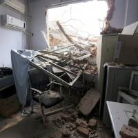 Rubble and debris lie in a room at the No. 4 Hospital of Zhengzhou University on Thursday after a demolition crew destroyed part of the facility in Zhengzhou in central China's Henan province. | AP