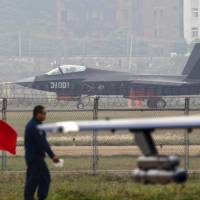 A Chinese People's Liberation Army Air Force J-31 stealth fighter lands on a runway after a flying performance at the 10th China International Aviation and Aerospace Exhibition in Zhuhai, Guangdong province, in November 2014. | REUTERS