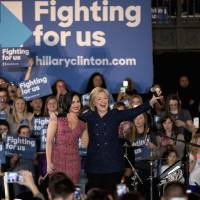 Democratic presidential candidate Hillary Clinton and musician Demi Lovato acknowledge the cheering crowd at a rally Thursday on the campus of University of Iowa in Iowa City, Iowa. Clinton has a lot of celebrity pals on her side, like singers Katy Perry or Demi Lovato. It's a play to help the former secretary of state connect with younger voters. But so far, the star power isn't swaying the college set. | AP