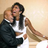 Motown Records founder Berry Gordyembraces singer Natalie Cole at the 2014 Carousel of Hope Ball at the Beverly Hilton Hotel, in Beverly Hills, California. | CHRIS PIZZELLO/INVISION/AP