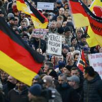Supporters of the anti-immigration right-wing movement PEGIDA (Patriotic Europeans Against the Islamisation of the West) take part Saturday in a demonstration march in Cologne, Germany, on Saturday in reaction to mass assaults on women on New Year's Eve. | REUTERS