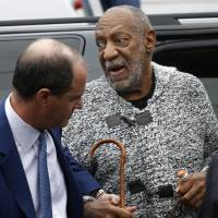 Actor and comedian Bill Cosby is helped as he arrives for a court appearance, Wednesday in Elkins Park, Pennsylvania. Cosby was arrested and charged with drugging and sexually assaulting a woman at his home in January 2004. | AP