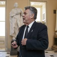 Rep. Peter King, R-N.Y., stands outside the House chamber on Capitol Hill in Washington last February.  King, who represents an evenly divided Long Island district, says Sen. Ted Cruz would definitely be a negative if he wins the Republican nomination.   AP