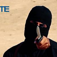 This image made from militant video, which has been verified by SITE Intelligence Group and is consistent with other AP reporting, shows Mohammed Emwazi, known as 'Jihadi John,' who appeared in several videos depicting the beheadings of Western hostages. SITE, which tracks terrorist activity, says the Islamic State group is acknowledging the death of the masked militant and published a 'eulogizing profile' of him on Tuesday in its English-language magazine Dabiq. | SITE INTELLIGENCE GROUP VIA AP