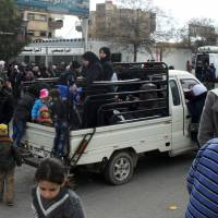 Amid truce, Syrians return to gutted Damascus ghost towns, Islamic State ranks exit Palestinian ghetto
