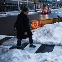 An abandoned plow blade is seen on L Street while the area recovers from a weekend blizzard Tuesday in Washington, D.C. | AFP-JIJI