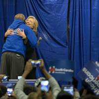 Democratic presidential candidate Hillary Clinton hugs Rep. Jim Clyburn before she speaks to a crowd at the Jim Clyburn Fish Fry, on Saturday at the Charleston Visitor Center in Charleston, South Carolina.   AP