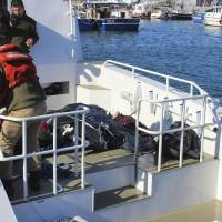 12 refugees found drowned on Turkish shore; hypothermia claims trio who reached Lesbos