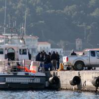 A coast guard vessel arrives with the bodies of migrants at the port of Vathi on the eastern Greek island of Samos on Thursday. Authorities in Greece have raised the death toll from a migrant boat sinking to 18, after recovering seven more bodies off the island of Samos in the eastern Aegean Sea. | AP